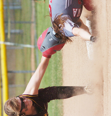 WARREN DILLAWAY / Star Beacon<br /> SARAH DEPP (9) of Geneva slides safely into second base beating the tag of Lilli Piper of Walsh Jesuit during a Division II regional semi-final game at Firestone Park in Akron.