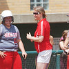 WARREN DILLAWAY / Star Beacon<br /> ELEISHA PITCHER (center), Geneva softball coach, shares a light moment with seniors Nicole Grimmett (left) and Sarah Depp on Thursday during a Division II regional semi-final game at Firestone Park in Akron.