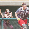 WARREN DILLAWAY / Star Beacon<br /> NICOLE GRIMMETT, Geneva catcher, returns to the field with the ball on Thursday durng a Division I regional semi-final game at Firestone Park in Akron.