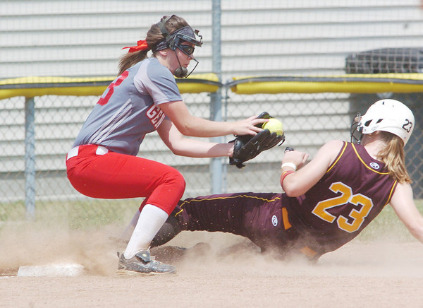 WARREN DILLAWAY / Star  Beacon<br /> LILLI PIPER of Walsh Jesuit slides safely in to third base as Alyssa Donato of Geneva catches the ball on Thursday during a Division II regional semi-final at Firestone Park in Akron.