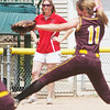 WARREN DILLAWAY / Star Beacon<br /> ELEISHA PITCHER, Geneva softball coach, watchesTaylor Rohach of Walsh Jesuit pitch on Thursday during a Division II regional semi-final at Firestone Park in Akron.