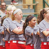 WARREN DILLAWAY / Star Beacon<br /> THE GENEVA girls softball team listens to the National Anthemn prior to the Division II regional semi-final game at Firestone Park in Akron on Tuesday afternoon.