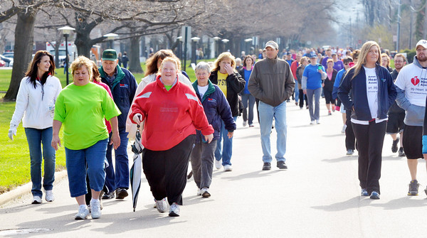 WARREN DILLAWAY / Star Beacon<br /> AMY BARKER of Ashtabula leads a goup of walkers across the finish line of the Ashtabula County Heart Walk on Saturday at Kent State University-Ashtabula Campus.