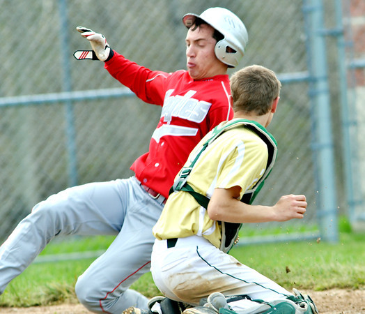 WARREN DILLAWAY / Star Beacon<br /> STEVE JEWELL (left) of Geneva slides by Jared Zeman,  Lakeside catcher, on Monday during a play at the plate. Jewell was called out.