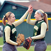 WARREN DILLAWAY / Star Beacon<br /> ANDREA DAVIS (left) and  Lakeside teammate Courtney Smith high five on Monday during a home game with Geneva.