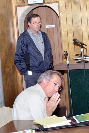 WARREN DILLAWAY / Star Beacon<br /> GREG SWEET, a Conneaut and North Kingsville businessman, (foreground) and Rich Behrendt, rail coordinator for the Ohio Department of Transportation (standing) attended a meeting concerning Route 20 bridge project on Monday at the North Kingsville Village Hall.