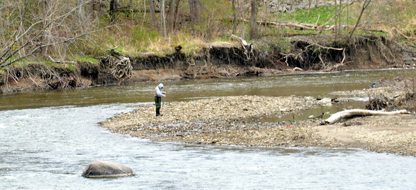 WARREN DILLAWAY / Star Beacon<br /> A LONE fishermen works Conneaut Creek near the Route 20 Viaduct near Old Main Road.