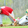 WARREN DILLAWAY / Star Beacon<br /> RYAN NAPPI (left) of Geneva tags out Josh O'Block of Lakeside on Monday during baseball action at Lakeside.