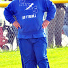 WARREN DILLAWAY / Star Beacon<br /> DAN FERTIG, Madison softball coach, watches the action on Tuesday during a game at Riverside.