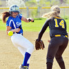 WARREN DILLAWAY / Star Beacon<br /> GABBY AMATO (left) of Madison gets hit by a pick off attempt as Kirsten Ponsart of Riverside watches on Tuesday at Riverside.