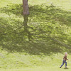 WARREN DILLAWAY / Star Beacon<br /> KIERNEN SPENCER, 3, of Pierpont Township, prepares to run up a hill at Lake Shore Park in Ashtabula Township Monday afternoon.