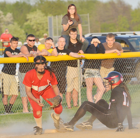 WARREN DILLAWAY / Star Beacon<br /> ASHTON NOCE (left) of Edgewood looks to the umpire after tagging Amanda Krause of Jefferson on Tuesday evening at Jefferson.