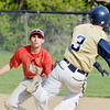 WARREN DILLAWAY / Star Beacon<br /> MATT DIDONATO (left), Edgewood shortstop, prepares to tag C.J. Rice of Conneaut at second base on Monday during baseball action at Skippon Park in Conneaut.