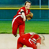 WARREN DILLAWAY / Star Beacon<br /> GIA SATURDAY of Edgewood throws to first base over teammate Taylor Rowe on Monday evening at Jeffereson.