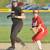 WARREN DILLAWAY / Star Beacon<br /> ALYSSA IRONS (left) of Jefferson and Taylor Rowe of Edgewood look to first base on Monday during a game at Jefferson.