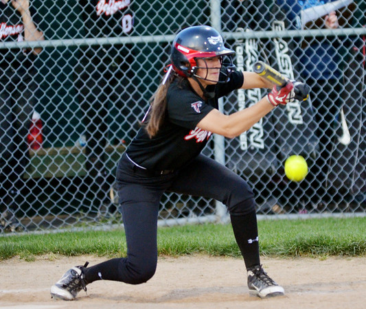 WARREN DILLAWAY / Star Beacon<br /> MCKENZIE WILBER of Jefferson bunts on Monday during a home game with Edgewood.