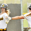 WARREN DILLAWAY / Star Beacon<br /> KAYLA LYNCH of Riverside celebrates with teammate Maggie Palumbo after scoring a run on Tuesday during a game at Geneva.