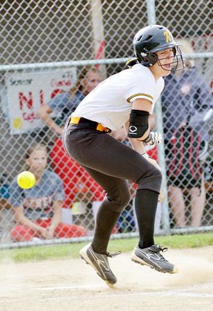 WARREN DILLAWAY / Star Beacon<br /> KAYLA LYNCH of Riverside gets hit by a pitch on Tuesday during a game at Geneva.