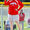 WARREN DILLAWAY / Star Beacon<br /> ELESHIA PITCHER, Geneva softball coach, signals to her team on Tuesday during a home game with Riverside.