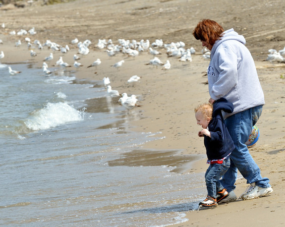 WARREN DILLAWAY / Star Beacon<br /> PRESTON KRAUS of Kingsville Township, 2, plays by the water's edge with Betty Krause, also of Kingsville Township on Thursday at Lake Shore Park in Ashtabula Township.