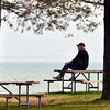 WARREN DILLAWAY / Star Beacon<br /> ED LYDEN of Canfield relaxes at Geneva State Park on Thursday afternoon.