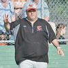 WARREN DILLAWAY / Star Beacon<br /> BILL LIPPS, Edgewood baseball coach, signals his team during a Division II district semifinal game at Havens Complex in Jefferson Township.