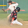WARREN DILLAWAY / Star Beacon<br /> JOEY CASARONA of Chagrin Falls forces Matt Barber of Jefferson during a Division II district semifinal game at Havens Complex in Jefferson Township.