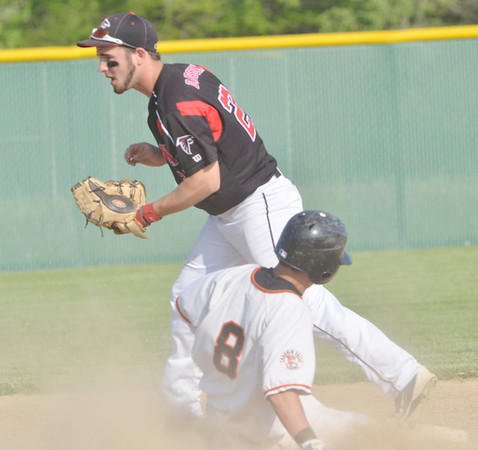 WARREN DILLAWAY / Star Beacon<br /> SCOTT DAVIDSON of Jefferson forces Danny Spain of Chagrin Falls at second base during a Division II district semifinal game at Havens Complex in Jefferson Township.