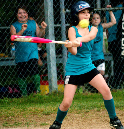 WARREN DILLAWAY / Star Beacon<br /> GRACE DICKEY of the Ashtabula Marlins Minor League team swings on Tuesday during a game at Carraher Field in Geneva.