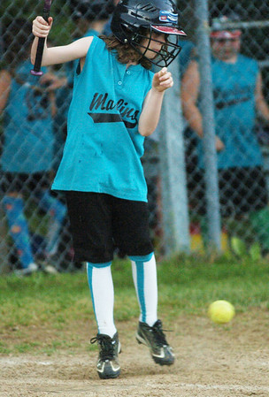 WARREN DILLAWAY / Star Beacon<br /> SYDNEY LINCOLN of the Ashtabula Minor League Marlins gets out of the way of a pitch on Tuesday during a game at Carraher Field in Geneva.