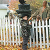 WARREN DILLAWAY / Star Beacon<br /> OZZY NESBITT, 9, of West Springfield, Pa., checks out the scary creatures at Randy Skalos's home on Williams Street in Conneaut Saturday during trick or treat night.