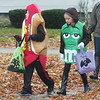 WARREN DILLAWAY / Star Beacon<br /> JIMMY RICH (left), 10, and Kiera Wyman, 9, both of Ashtabula, trick or treat along Walnut Boulevard in Ashtabula on Saturday afternoon.