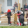 WARREN DILLAWAY / Star Beacon<br /> SPOOKY CREATURES greet and visit along Madison Street in Conneaut Saturday during trick or treat night.
