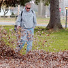 WARREN DILLAWAY / Star Beacon<br /> BUTCH EATON blows leaves at the intersection of Lake Road and Mill Street in Conneaut Friday afternoon.