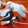 WARREN DILLAWAY / Star Beacon<br /> TONY MAGDA (top) wrestles with Edgewood teammate Tyler DuFour during the second day of practice Saturday at Edgewood High School.