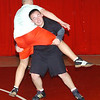 WARREN DILLAWAY / Star Beacon<br /> NICK CAMP wrestles with Edgewood teammate Seth Tackett during the second day of practice Saturday at Edgewood High School.