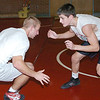 WARREN DILLAWAY / Star Beacon<br /> TONY MAGDA wrestles with Edgewood teammate Tyler DuFour during the second day of practice Saturday at Edgewood High School.