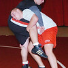 WARREN DILLAWAY / Star Beacon<br /> NICK CAMP  (head center) wrestles with Edgewood teammate Seth Tackett during the second day of practice Saturday at Edgewood High School.