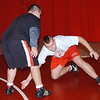 WARREN DILLAWAY / Star Beacon<br /> NICK CAMP (left) wrestles with Edgewood teammate Seth Tackett during the second day of practice Saturday at Edgewood High School.