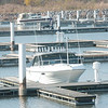 WARREN DILLAWAY / Star Beacon<br /> TWO PEOPLE walk the nearly vacant docks of the Geneva State Park Marina Saturday afternoon.