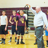 WARREN DILLAWAY / Star Beacon<br /> RYAN FITCH, Pymatuning Valley basketball coach, instructs his team Tuesday during practice.