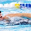 WARREN DILLAWAY / Star Beacon<br /> LAUREN BUZZARD of Jefferson, warms up for swim practice on Thursday night at Spire Institute.