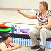 WARREN DILLAWAY / Star Beacon<br /> LINDA SCHIFF (right), a volunteer assistant swim coach for Lakeside, gestures while talking to Melissa Mosier during swim practice at Spire Institute on Thursday night.