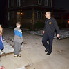 WARREN DILLAWAY / Star Beacon<br /> DALE ARKENBURG, Geneva firefighter, greets Kennedy (left), 10, and Ethan, 9, Bales during a family coordinated fire drill on East Main Street in Geneva early Thursday morning.
