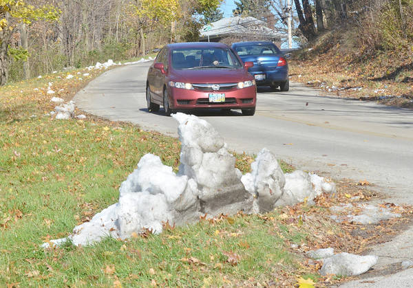 WARREN DILLAWAY / Star Beacon<br /> A SNOW pile survived warming temperatures on Thursday afternoon near the entrance to Cederquist Park along Tannery Hill Rodin A