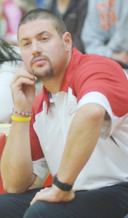 WARREN DILLAWAY / Star Beacon<br /> STEVE KRAY, Edgewood girls basktball coach, watches the action during the Edgewood Preview on Friday evening in Ashtabula Township.