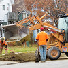 WARREN DILLAWAY / Star Beacon<br /> A CONNEAUT city crew works along Chestnut Street in Conneaut Friday afternoon. Warm temperatures made outdoor work and recreation a bit more pleasant.