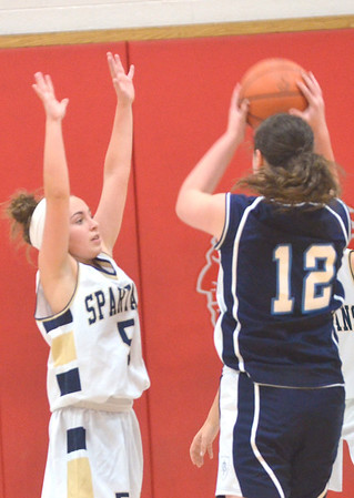 WARREN DILLAWAY / Star Beacon<br /> JESSICA THOMPSON (5) of Conneaut defends Mackenzie Stenroos of St. John on Friday night during the Edgewood Preview.