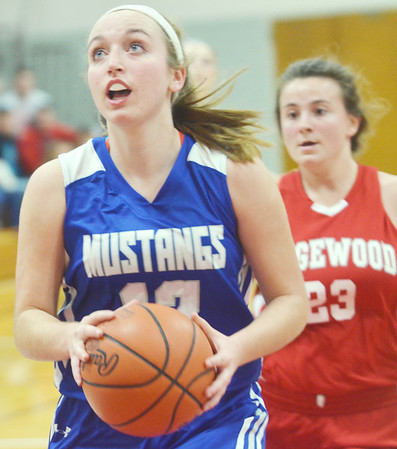 WARREN DILLAWAY / Star Beacon<br /> JESSICA VORMELKER of Grand Valley drives to the basket with Gia Saturday of Edgewood in hot pursuit on Friday night during the Edgewood Preview.