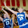 WARREN DILLAWAY / Star Beacon<br /> RAEANN BENEDICT (13) of St. John drives to the basket as Chris Futty of Grand Valley defends on Friday night durig the Edgewood Preview.